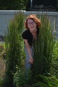 I don't know why I'm in a bush, but I look pretty happy.